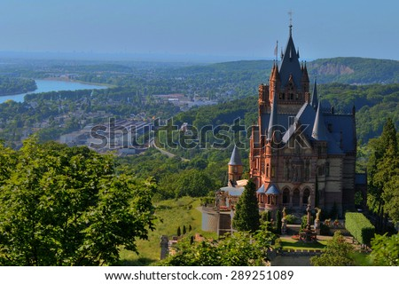 A German medieval castle and an urban view behind, Bonn Germany  - stock photo