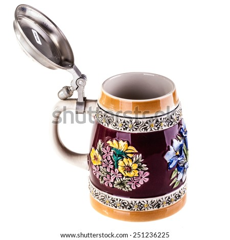 a german or austrian beer mug isolated over a white background - stock photo