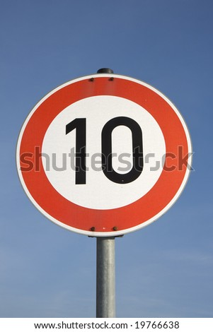 a german speed limit sign outdoors