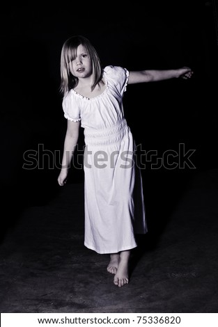 A ghostly looking girl wearing a white night gown - stock photo