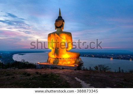 A giant Buddha image statue looking to Mekong river - stock photo