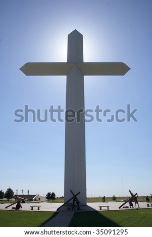 a giant cross lit up by the sun