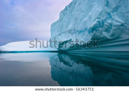 a giant iceberg floating on the waters of east greenland - stock photo