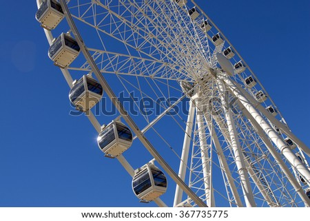 A giant white ferris wheel with clear blue sky at Southbank, Brisbane, Australia, Horizontal - stock photo