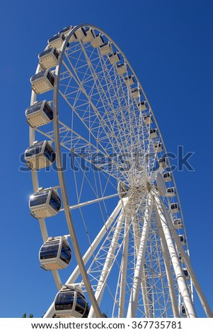 A giant white ferris wheel with clear blue sky at Southbank, Brisbane, Australia, Vertical