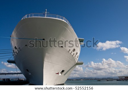 A giant white luxury cruise ship rising into a blue sky