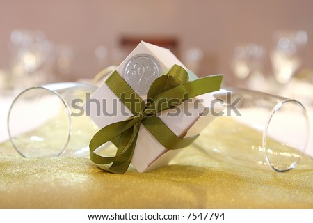 A gift box and green ribbons with glasses - stock photo