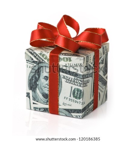 A gift box covered in US money with red colored ribbon applied - stock photo