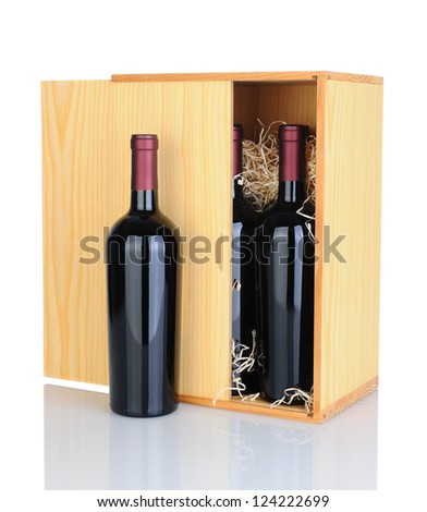 A gift box of cabernet sauvignon wine bottles isolated on white with reflection. - stock photo