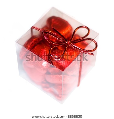 a gift box with red hearts made of chocolate