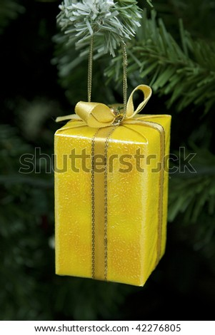 a gift hangs on pine branch - stock photo