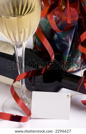 A gift of wine for that special event with a blank tag attached - stock photo