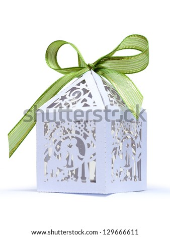 A gift wrap tied with green ribbon - stock photo