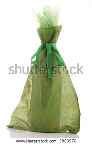 a gift wrapped wine bottle over a white background