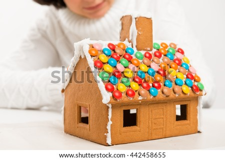a gingerbread house at the moment of decoration closeup