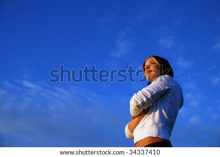 A girl and a blue sky. - stock photo