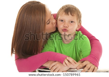 A girl and a young boy both making a kiss face. - stock photo