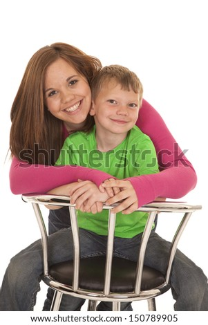 A girl and a young boy sitting together with smiles. - stock photo
