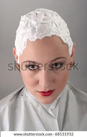 A girl before shaving off her hair - stock photo