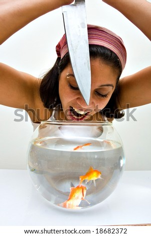 a girl catching fish from a bawl