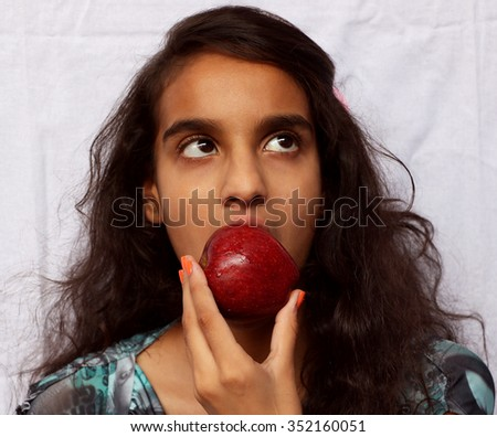A girl child eating apple