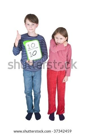 A girl coughs or sneezes into her elbow, and a boy makes a thumbs up sign - its one of the ways to prevent the spread of swine flu. He is holding a tablet on which is written a score of 10 out of 10. - stock photo