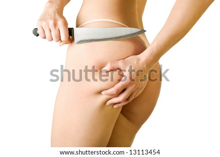 a girl cut off her cellulite, isolated on white