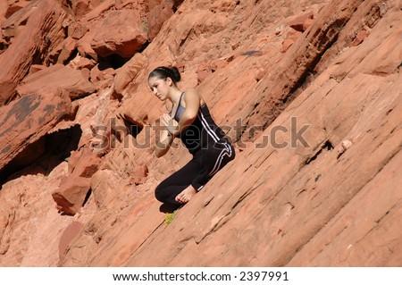 A girl doing yoga in Red Rock Canyon, Las Vegas Nevada - stock photo