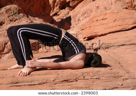 A girl doing yoga in Red Rock Canyon, Las Vegas Nevada - stock photo