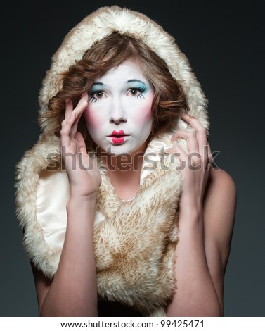 a girl dressed up as an old vintage porcelain doll - stock photo