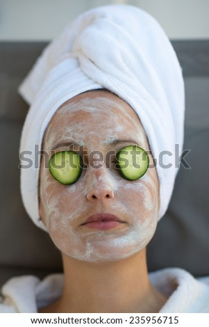 a girl during a beauty face mask - stock photo