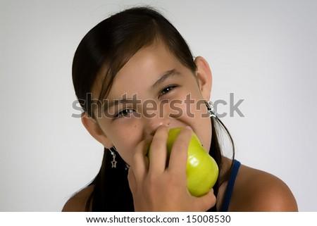 A girl eating green apple - stock photo
