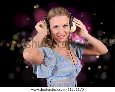 A girl having fun on the background of bright lights in the disco