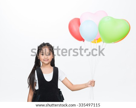 A girl  holding a balloon in hand on white background.