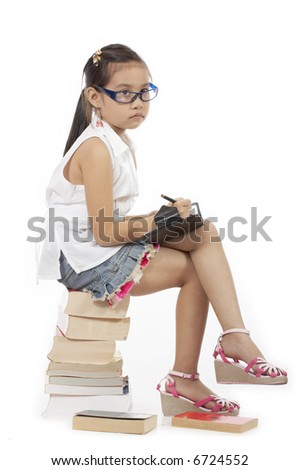 a girl holding a pen and a personal organizer while sitting