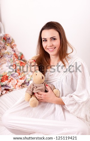 A girl holding a stuffed toy rabbit