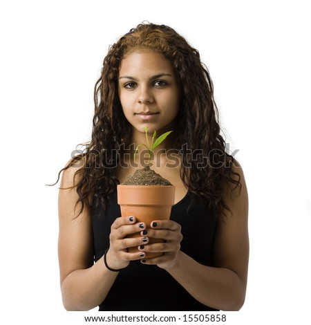 A girl holds a potted plant - stock photo