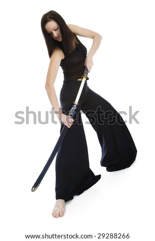 A girl in a black dress with a Japanese sword