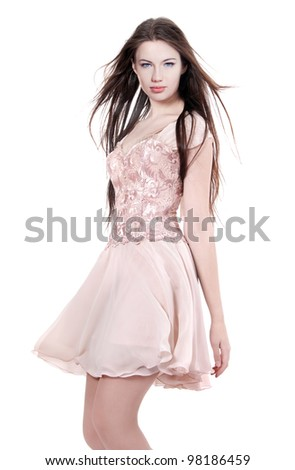 A girl in a dress dancing - stock photo