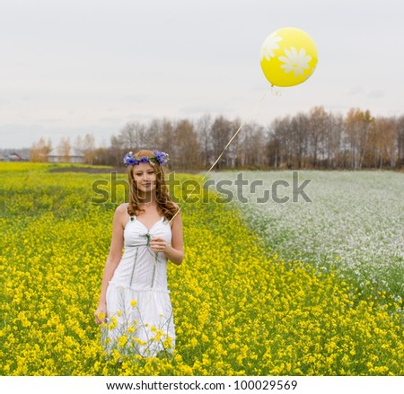 A girl in a field with a balloon