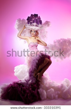 a girl in a long dress in a lush cloud air lock on the head