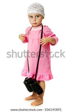 A girl in a pink dress with a pair of binoculars on a white background.