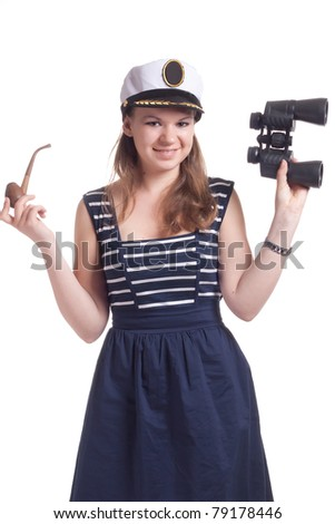 A girl in a sailor cap holding a pair of binoculars and a pipe for smoking on a white background