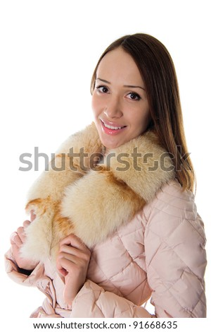 A girl in a warm jacket looking straight - stock photo