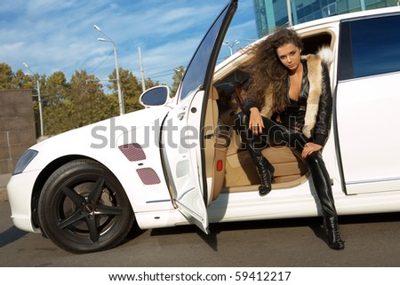 A girl in a white car - stock photo