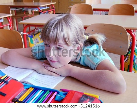 a girl in class listening a lesson - stock photo