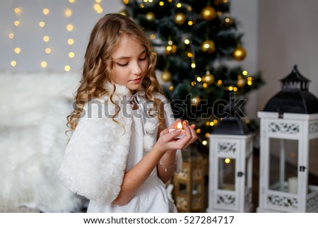 girl front firtree candle new years stock photo edit now 527284717
