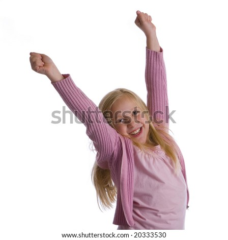 A girl in pink jumps for joy - stock photo