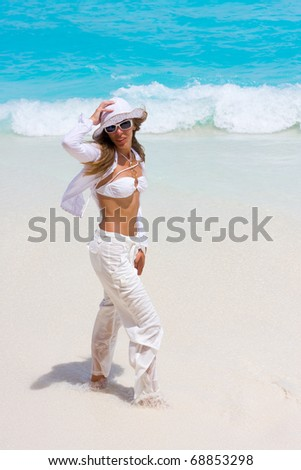 A girl is in white on a beach - stock photo
