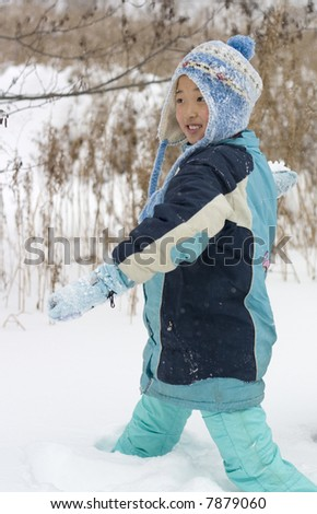 a girl is playing snowball